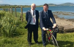 Minister Kelly with Cathaoirleach John Brassil.