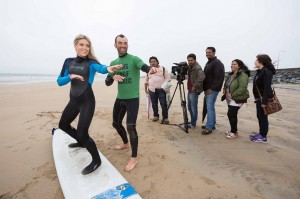 TV presenter Olivia Cox getting a surf lesson from Ben Bennett, Ben's Surf Clinic in Lahinch.