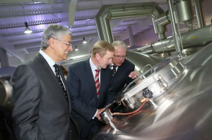 An Taoiseach peering into a fermentation tank.