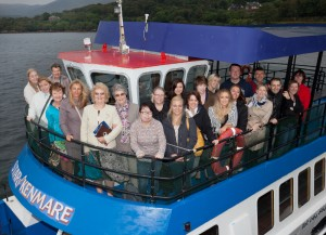 British tour operators with Debbie Moran (front, fourth right) and Judith Cassidy (front, fifth right), both Tourism Ireland, taking part in a cruise of Kenmare Bay.