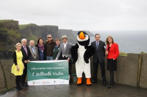 Celebrating with the one millionth visitor at the cliff edge.
